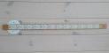 LED-strips teipet på trelamell brukt som taklys